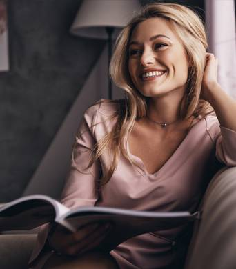 Healthy woman smiling at home